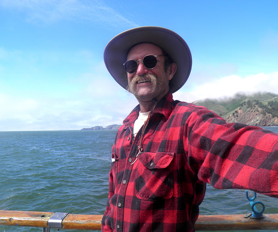 David D. Hunter, certified arborist, with backdrop of ocean on a boat